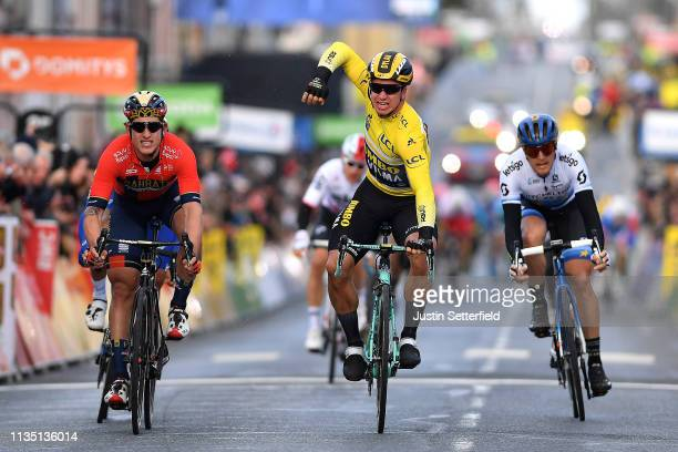 Arrival / Dylan Groenewegen of Netherlands and Team Jumbo Visma Yellow Leader Jersey / Celebration / Ivan Garcia Cortina of Spain and Team Bahrain...