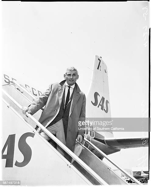 Arrival, Jeff Chandler, It's home again for Jeff Chandler who returned today aboard SAS airliner from Germany', April 27, 1958.