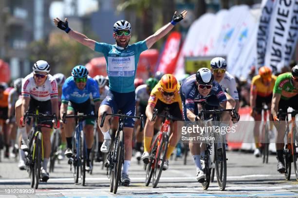 Arrival / Mark Cavendish of United Kingdom and Team Deceuninck - Quick-Step Turquoise Leader Jersey Celebration & Jasper Philipsen of Belgium and...