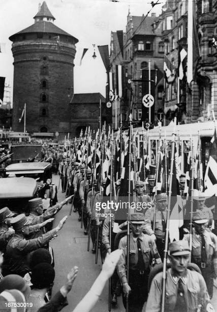 Arrival of participants at the Nuremberg Reichsparteitag In the background The King's Tower of Nuremberg September 1st 1933 Photograph Ankunft von...
