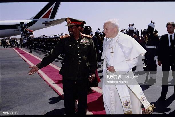 Arrival of Polish Pope John Paul II at Khartoum airport He's welcomed by Prime Minister of Sudan General Omar alBashir