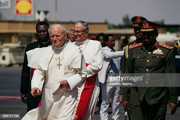 Arrival of Polish Pope John Paul II at Khartoum airport He's welcomed by Prime Minister of Sudan General Omar alBashir