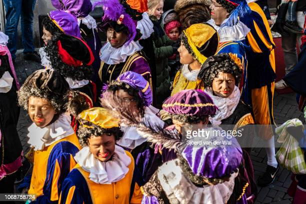 Arrival of Sinterklaas in the city of Kampen where the helpers the Black Petes are walking through the crowded shopping street on November 17 2018 in...