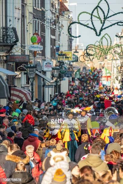 Arrival of Sinterklaas in the city of Kampen where the old Saint is riding his horse through the crowded shopping street surrounded by his helpers...