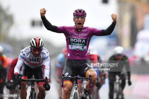 Arrival / Pascal Ackermann of Germany and Team Bora Hansgrohe Purple Points Jersey / Celebration / Fernando Gaviria Rendon of Colombia and UAE Team...