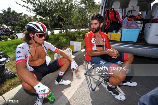 Arrival / Roberto Ferrari of Italy and UAE - Team Emirates / Fernando Gaviria of Colombia and UAE - Team Emirates Red Leader Jersey / Refreshment /...