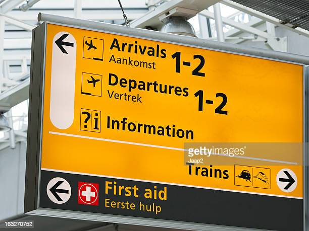 arrivals and departures sign at amsterdam schiphol airport - schiphol airport stock photos and pictures