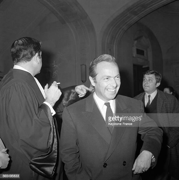 Arrivée de Guy Lux à l'audience de la Chambre Correctionnelle de la Seine cité comme témoin au procès d'AnneMarie Peysson speakerine de la télévision...