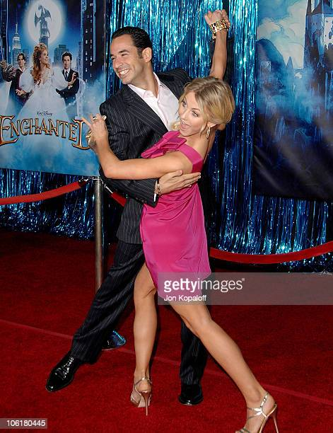 arrive Race car driver Helio Castroneves and dancer Julianne Hough arrive at the Los Angeles Premiere 'Enchanted' at the El Capitan Theater on...