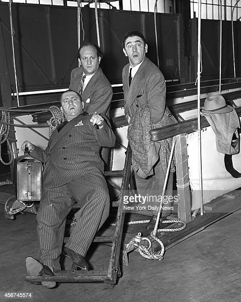 3 BRITONS arrived on the Queen Mary Thespians all they are known as The Three Stooges They slap faces poke eyes and kick pants for a living Top Larry...