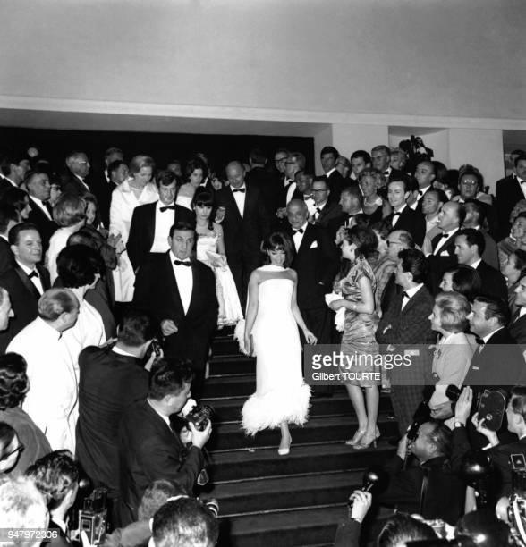 Arrivee de JeanPaul Belmondo et sa femme Elodie Lino Ventura et Andrea Parisy au Festival de Cannes en 1964 Cannes France