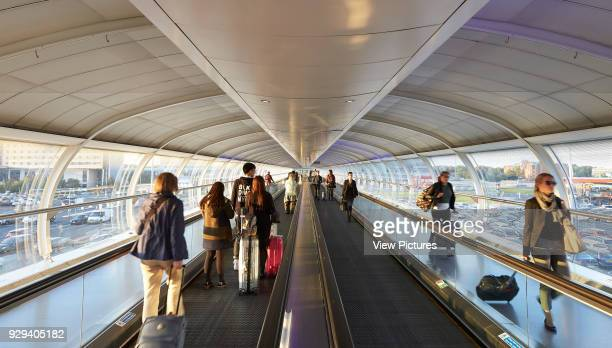 Arriving and departing travelers in Skylink Walkway Manchester Airport Manchester United Kingdom Architect n/a 2015