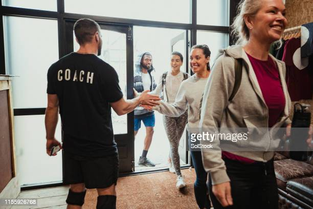 arriving for an exercise class - entering stock pictures, royalty-free photos & images