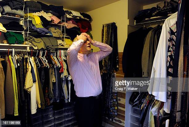 Arriving home Denver Athletics Club CEO General Manager Andre van Hall shows fatigue as he prepare his clothes for the following day Littleton CO...