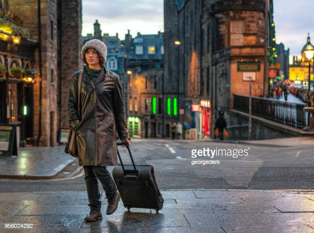 arriving in edinburgh, scotland - wheeled luggage stock photos and pictures