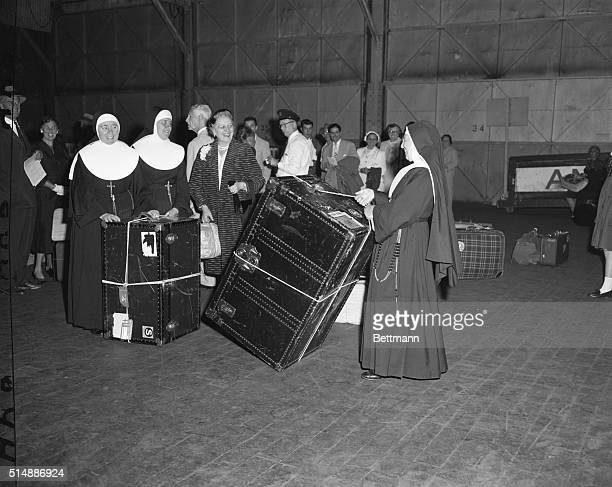 Arriving on the SS Saturnia this morning these Sisters of Mercy enroute from Rome to Your PA were among the passengers who had to practice 'do it...