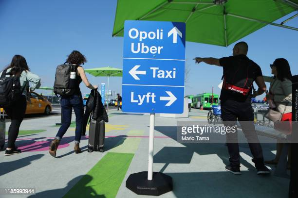Arriving passengers prepare to board vehicles at the new 'LAXit' ridehail passenger pickup lot at Los Angeles International Airport on November 6...