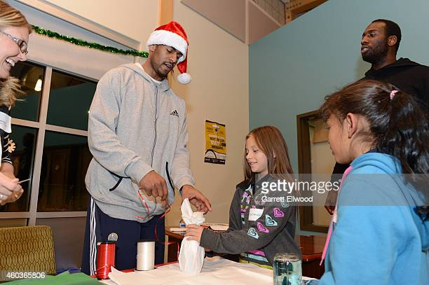 Arron Afflalo and JJ Hickson of the Denver Nuggets visits kids and wrap gifts at the Vickers Boys Girls Club during the NBA Season of Giving on...