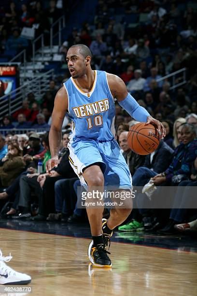 Arron Afflalo of the Denver Nuggets drives against the New Orleans Pelicans on January 28 2015 at Smoothie King Center in New Orleans Louisiana NOTE...