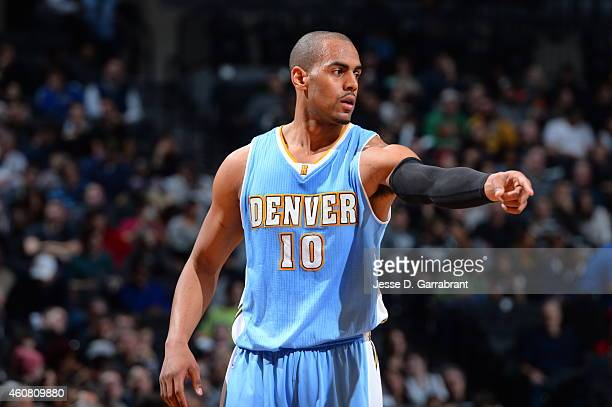 Arron Afflalo of the Denver Nuggets gives direction to his team against the Brooklyn Nets on December 23 2014 at the Barclays Center in Brooklyn NY...