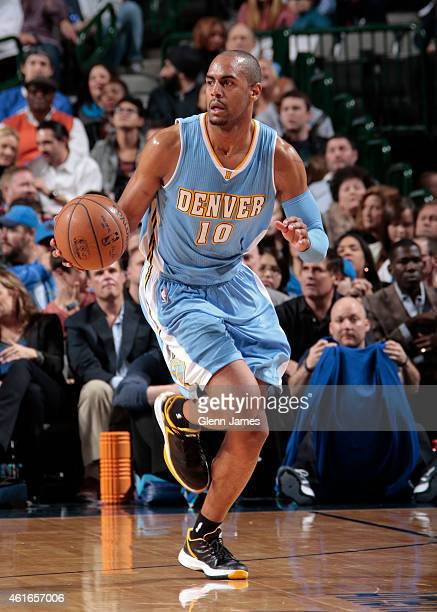 Arron Afflalo of the Denver Nuggets handles the ball against the Dallas Mavericks on January 16 2015 at the American Airlines Center in Dallas Texas...
