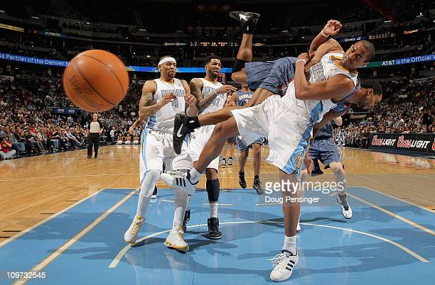 Arron Afflalo of the Denver Nuggets is fouled by Gerald Henderson of the Charlotte Bobcats as he tries to layup a shot at the Pepsi Center on March 2...