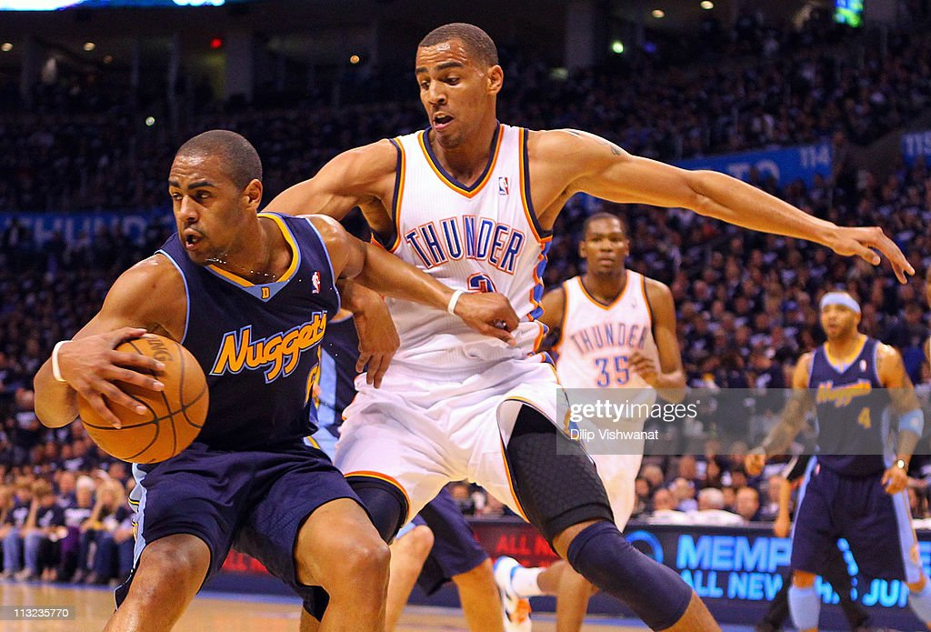 Arron Afflalo #6 of the Denver Nuggets looks to get past Thabo Sefolosha #2 of the Oklahoma City Thunder in Game Five of the Western Conference Quarterfinals in the 2011 NBA Playoffs on April 27, 2011 at the Ford Center in Oklahoma City, Oklahoma.