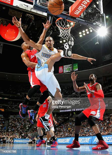 Arron Afflalo of the Denver Nuggets looses control of the ball against Randy Foye of the Los Angeles Clippers at Pepsi Center on April 18 2012 in...