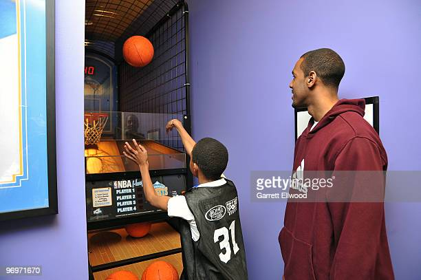 Arron Afflalo of the Denver Nuggets plays a game with a patient on February 22 2010 at the Children's Hospital in Aurora Colorado NOTE TO USER User...