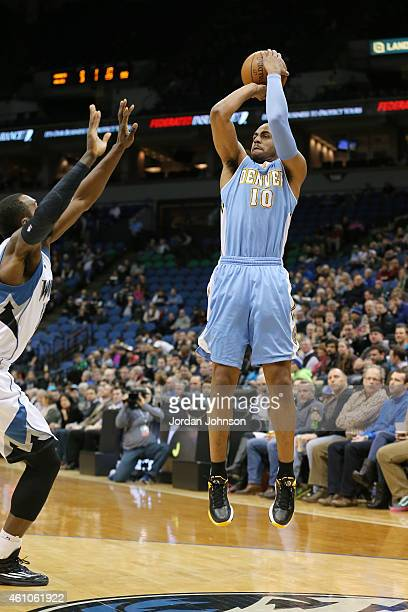 Arron Afflalo of the Denver Nuggets shoots against the Minnesota Timberwolvesduring the game on January 5 2015 at Target Center in Minneapolis...