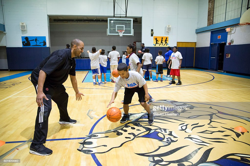 Arron Afflalo #4 of the New York Knicks host an NBA Cares clinic for Good Morning America at the Madison Square Boys and Girls Club on December 12, 2015 in Bronx, New York.