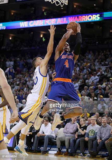 Arron Afflalo of the New York Knicks is fouled by Stephen Curry of the Golden State Warriors at ORACLE Arena on March 16 2016 in Oakland California...