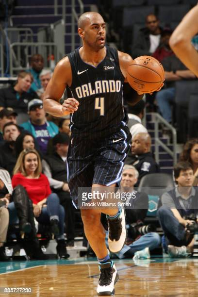 Arron Afflalo of the Orlando Magic dribbles the ball down court as they face the Charlotte Hornets on December 4 2017 at Spectrum Center in Charlotte...