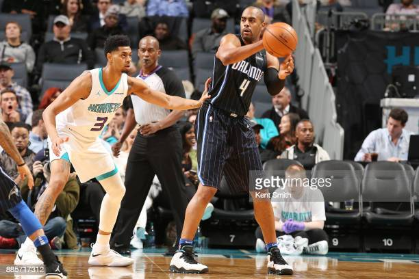 Arron Afflalo of the Orlando Magic looks to pass the ball against the Charlotte Hornets on December 4 2017 at Spectrum Center in Charlotte North...