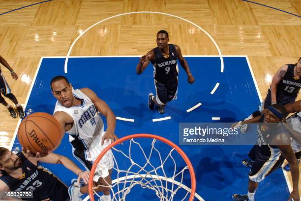 Arron Afflalo of the Orlando Magic shoots a layup against the Memphis Grizzlies during the game on October 18 2013 at Amway Center in Orlando Florida...