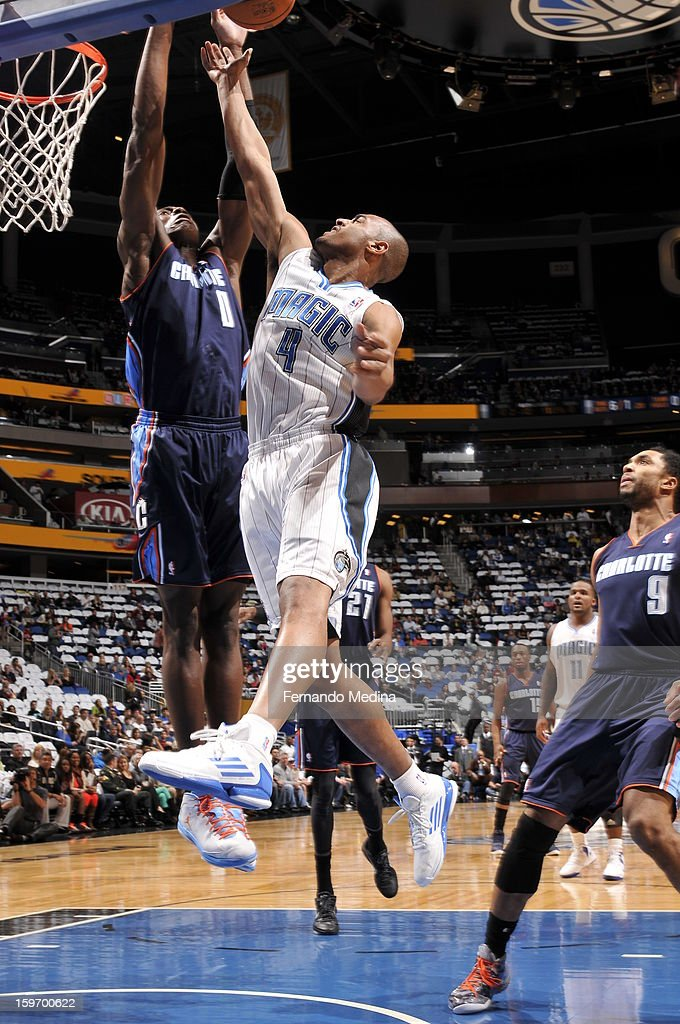 Arron Afflalo #4 of the Orlando Magic shoots against Bismack Biyombo #0 of the Charlotte Bobcats on January 18, 2013 at Amway Center in Orlando, Florida.