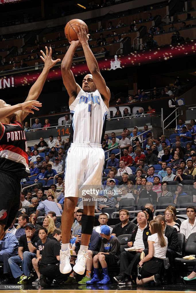 Arron Afflalo #4 of the Orlando Magic shoots the ball against Damian Lillard #0 of the Portland Trail Blazers during the game on February 10, 2013 at Amway Center in Orlando, Florida.