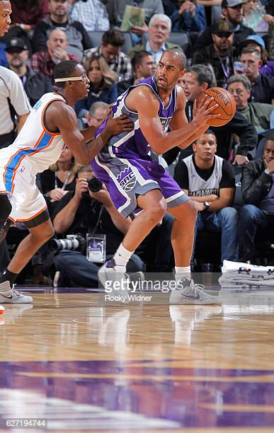 Arron Afflalo of the Sacramento Kings handles the ball against Semaj Christon of the Oklahoma City Thunder on November 23 2016 at Golden 1 Center in...