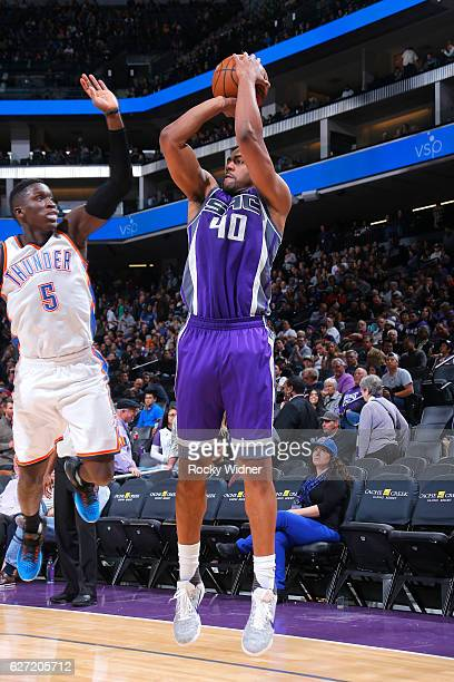 Arron Afflalo of the Sacramento Kings shoots against Victor Oladipo of the Oklahoma City Thunder on November 23 2016 at Golden 1 Center in Sacramento...
