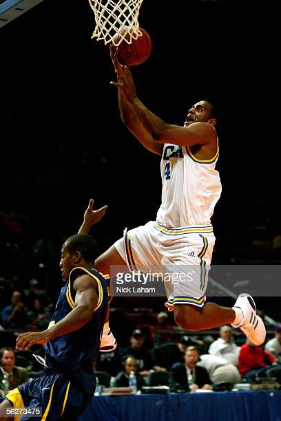 Arron Afflalo of the UCLA Bruins goes in for a layup over Randy Hampton of the Drexel Dragons during their Preseason NIT Tournament game at Madison...