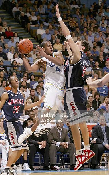 Arron Afflalo of the UCLA Bruins passes under pressure from Ivan Radenovic of the Arizona Wildcats on February 4 2006 at Pauley Pavillion in Westwood...