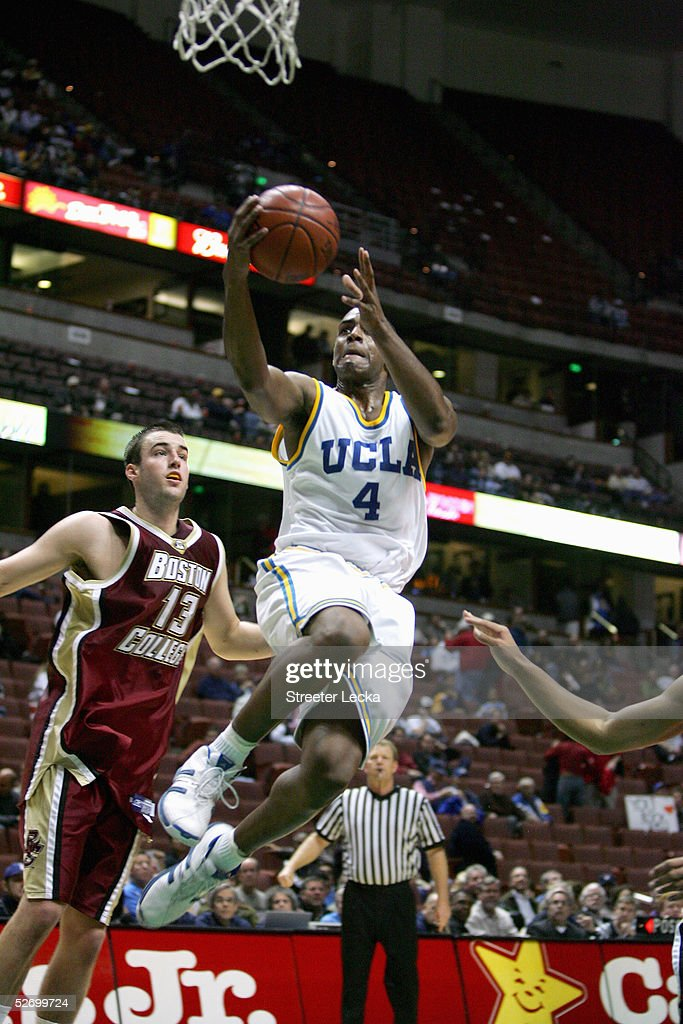 Arron Afflalo #4 of the UCLA Bruins shoots a layup against Nate Doornekamp #13 of the Boston College Eagles on December 5, 2004 at The Arrowhead Pond in Anaheim, California. Boston College won 74-64.