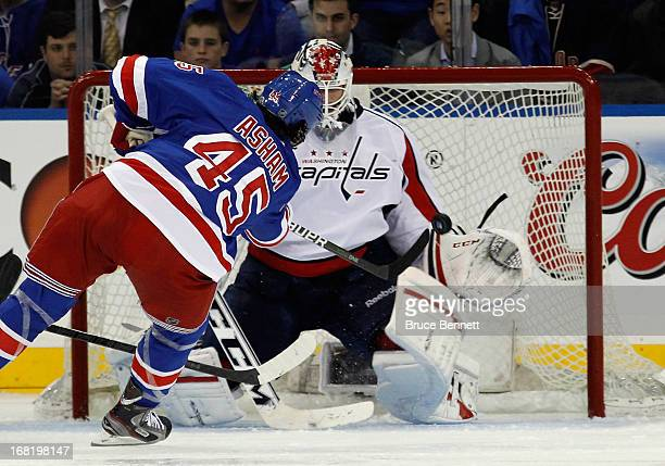 Arron Asham of the New York Rangers scores at 253 of the third period against Braden Holtby of the Washington Capitals in Game Three of the Eastern...