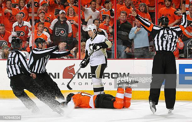 Arron Asham of the Pittsburgh Penguins is given a 10minute match penalty after a hit to the head of Brayden Schenn of the Philadelphia Flyers in Game...
