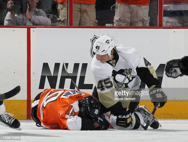 Arron Asham of the Pittsburgh Penguins punches Brayden Schenn of the Philadelphia Flyers in Game Three of the Eastern Conference Quarterfinals during...