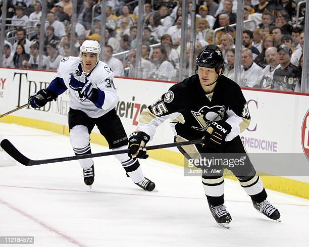 Arron Asham of the Pittsburgh Penguins skates against the Tampa Bay Lightning in Game One of the Eastern Conference Quarterfinals during the 2011 NHL...