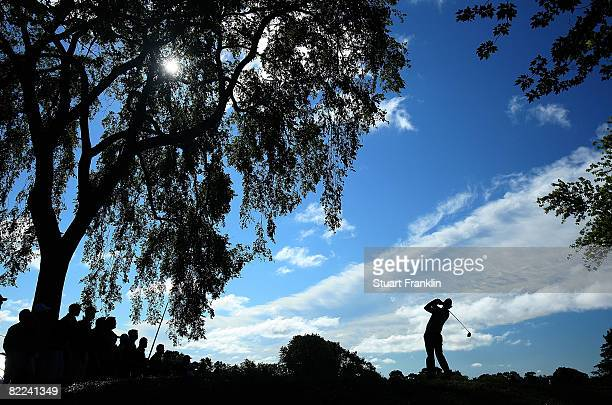 Arron Baddeley of Australia plays his tee shot on the 12th hole during the completion of round three of the 90th PGA Championship at Oakland Hills...