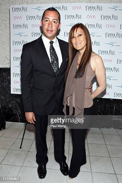 Arron Cathcart and Nancy Koide of OYA pose for a photo at the Capitol File Magazine cover party at Oya Restaurant on April 7 2010 in Washington DC