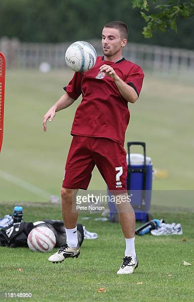 Arron Davies of Northampton Town in action during a training session at Moulton College on July 2 2011 in Northampton England