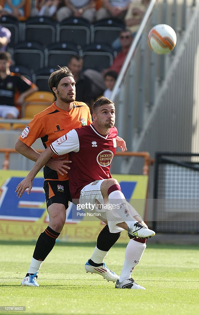 Arron Davies of Northampton Town looks to control the ball under pressure from Daniel Leach of Barnet during the npower League Two match between Barnet and Northampton Town at Underhill Stadium on October 1, 2011 in Barnet, England.